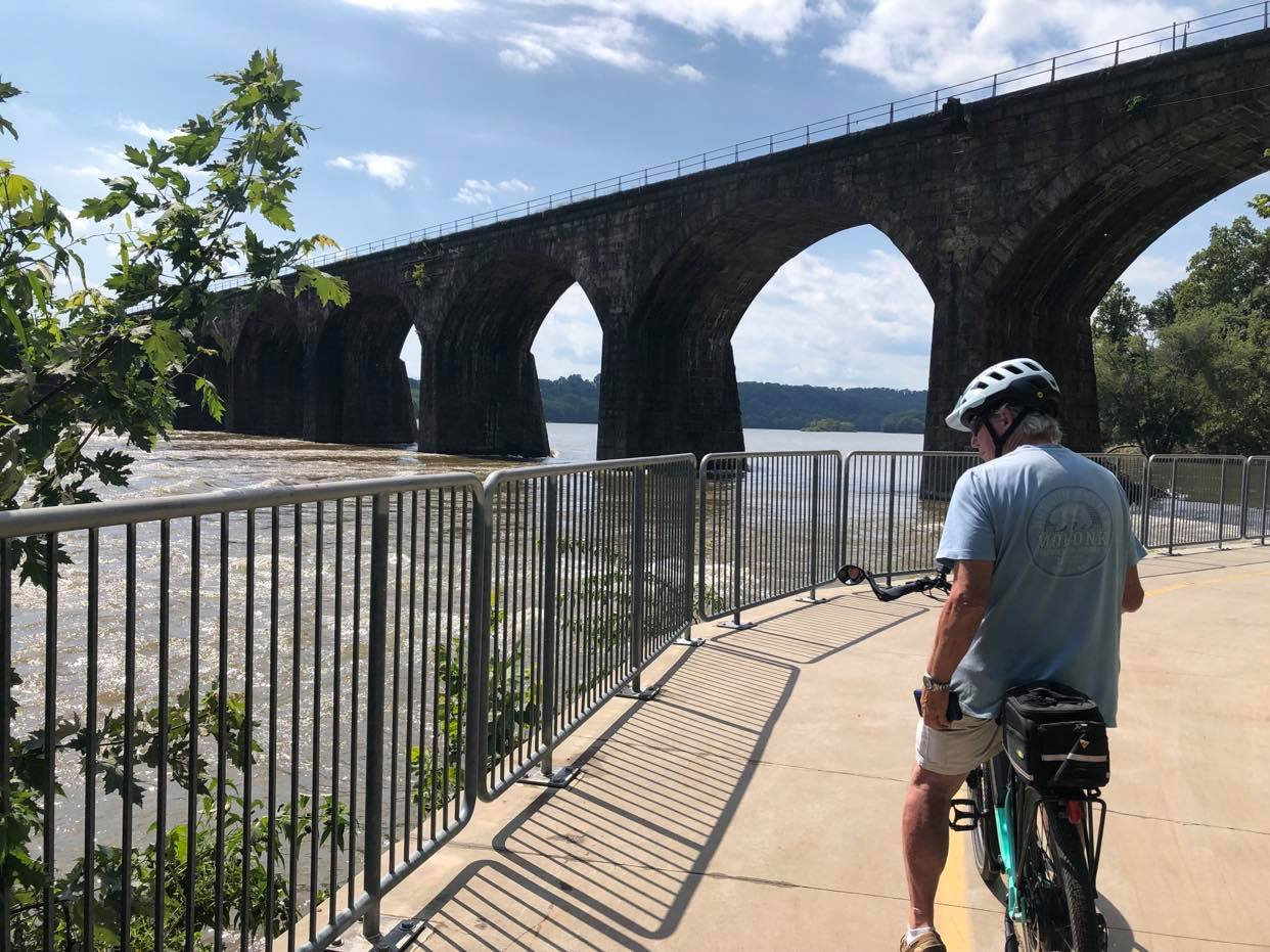 bike rider near bridge