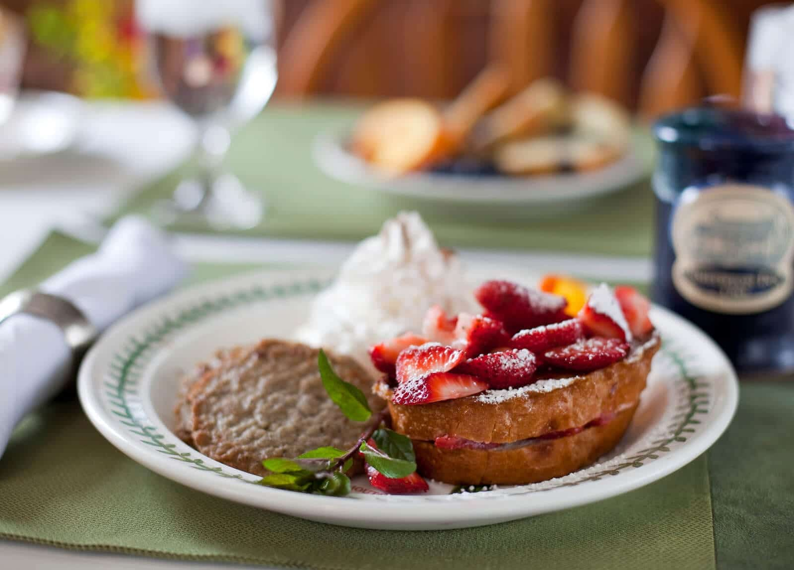 Close up of French Toast with strawberries and powder sugar