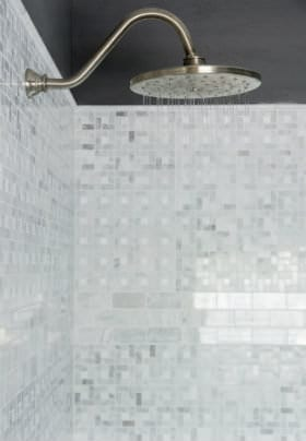 Rain Shower shower head with grey carrera marble tile