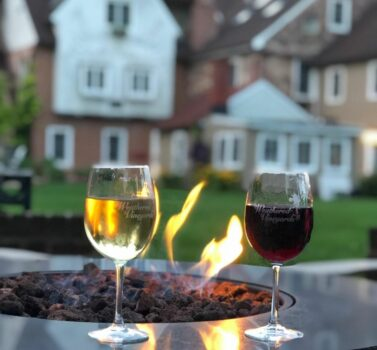 Wine and Fire Pit with historic bed and breakfast in background