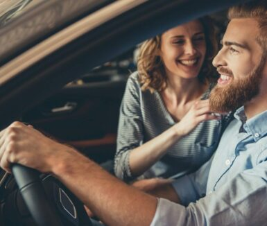 Couple smiling at each other in a car while on a Lancaster County Day Trips