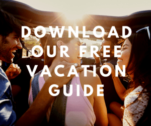group of young adults in a car with overlaying text download our free vacation guide