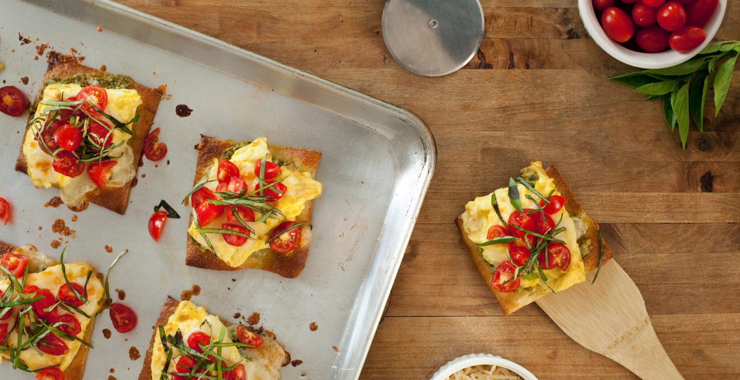 Margarita Breakfast Pizza with bright red tomatoes from the garden in a bowl