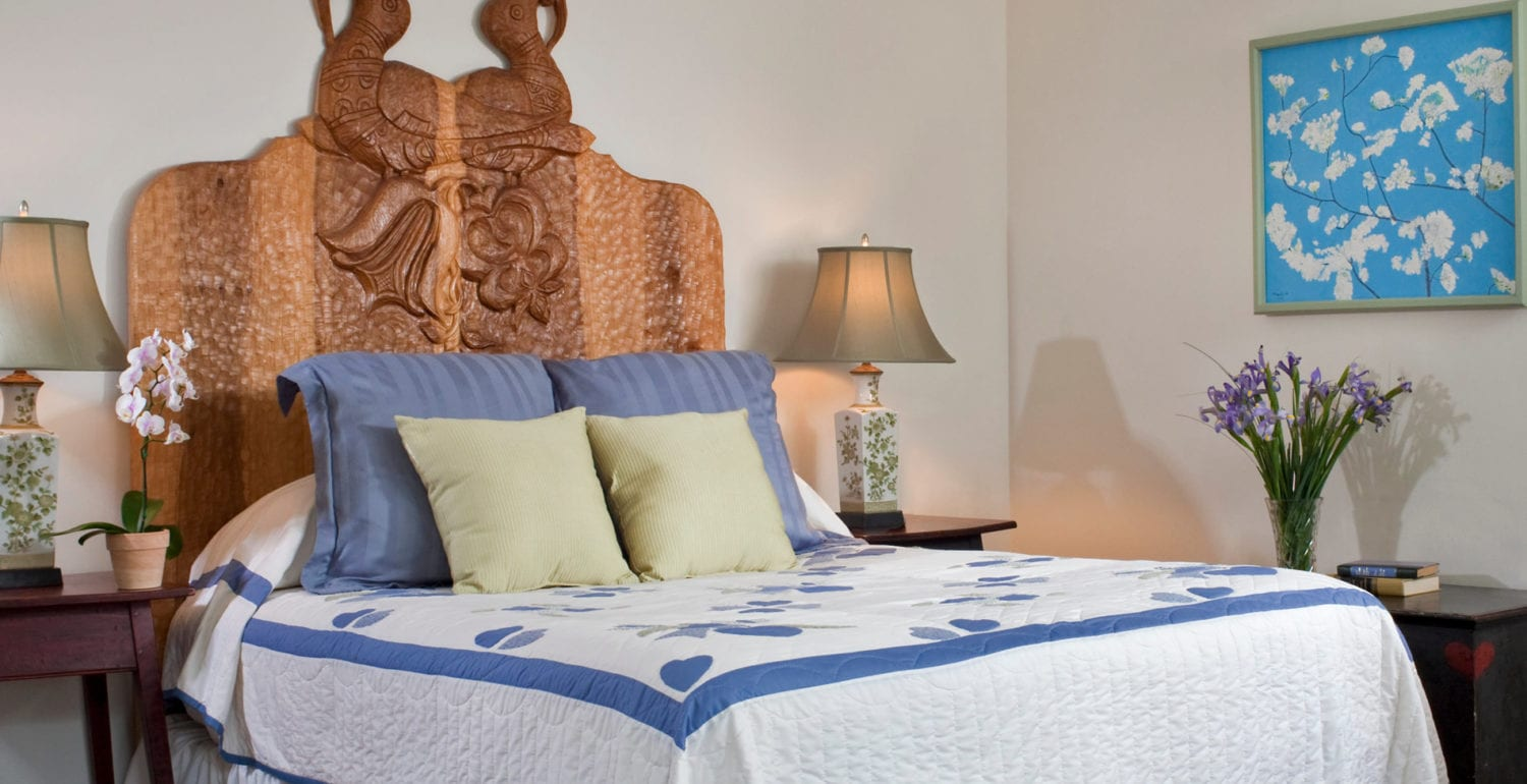 The sage room has a queen sized, hand carved bed with PA Dutch design carved into it