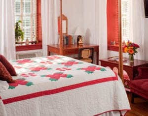 The Red Room wiht handsewn Amish Quilt